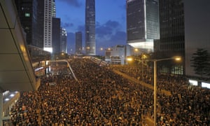 Tens of thousands of protesters march on Sunday near the Legislative Council in Hong Kong.