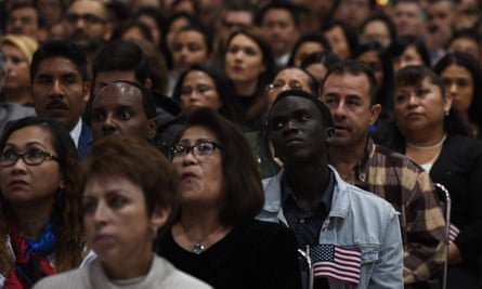 US immigrants prepare to pledge allegiance as they receive citizenship at a naturalization ceremony in Los Angeles.