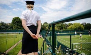 A security staff member watches a training session at the practice courts in Wimbledon, London.