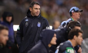 Drenched Blues coach Brad Fittler looks on as the Blues run rampant.
