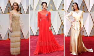Emma Stone, Ruth Negga, and Dakota Johnson on the red carpet the Oscars