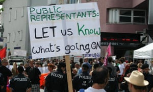 Protesters march in Austria against lobbying taking place at the Bilderberg summit.