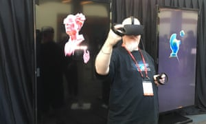 A participant at Oculus Connect 3 tries out the Avatar program on an Oculus headset.