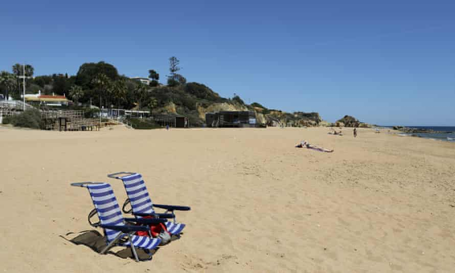 two empy beach chairs on an empty beach on the Algarve