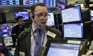 Trader Edward Curran works on the floor of the New York Stock Exchange today.