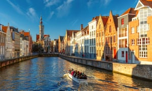 A tourist boat on the canal Spiegelrei in Bruges. The city is visited by more than 8 million people every year.