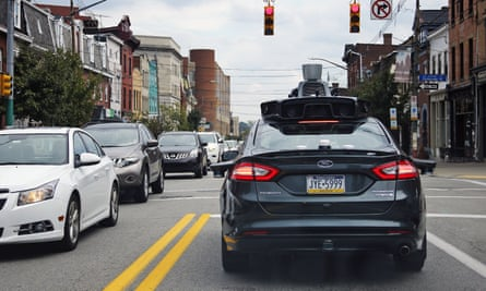 A self-driving Uber car drives in Pittsburgh. The vehicles must be equipped with cybersecurity gear, according to a House measure.