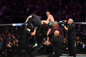 McGregor sets off in pursuit but is held back. Members of Nurmagomedov's own team then enter the ring and attack McGregor.