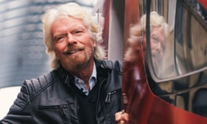 Richard Branson in the doorway of a Virgin train