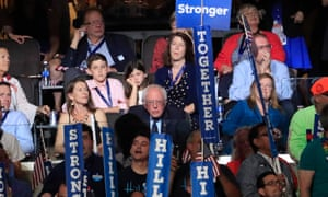 Bernie Sanders listens as Hillary Clinton speaks during final day of the Democratic national convention.