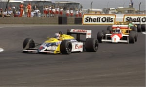 Nigel Mansell is pursued by Alain Prost