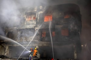 Firefighters tackling a blaze that started in a chemical store at an apartment building in the Chawkbazar area of the capital, killing at least 80 people