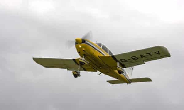 A Piper Cherokee light aeroplane taking off from Breighton airfield, in West Yorkshire