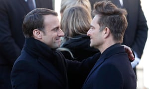Johnny Hallyday's son David Hallyday greets French President Emmanuel Macron prior to the funeral