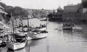 A still from Mallorca shows fishermen aboard their boats.