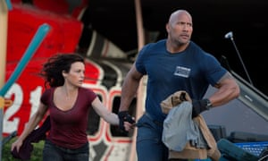 Dwayne Johnson, right, came top of Forbes' list ahead of Jackie Chan, Matt Damon and Tom Cruise. Melissa McCarthy, the world's second-highest paid female actor, would not make it into the male top 10.