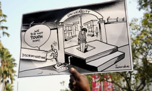 A caricature is held up at a student protest in Guwahati after the death of a student Rohith Vemula.