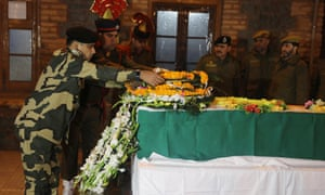 An Indian officer lays a wreath on the coffin of deputy superintendent of police Aman Thakur in Kashmir on Sunday