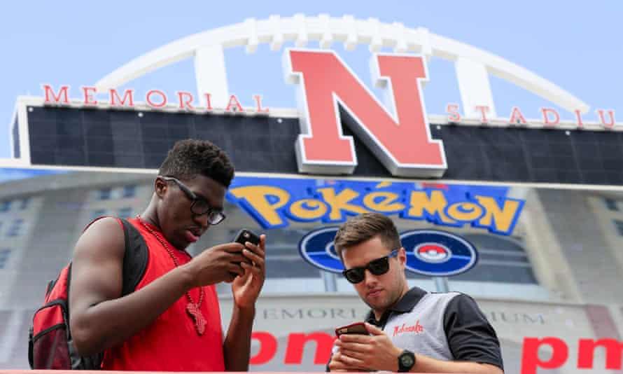 Pokémon Go players eager to capture Pokémon outside a sports stadium in Nebraska.