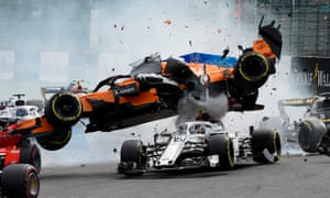 Fernando Alonso's McLaren crashes on top of Sauber's Charles Leclerc during the first lap of the Belgian Grand Prix in August