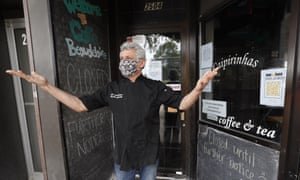 A restaurateur stands in front of his temporarily closed venue in  Ames, Iowa.