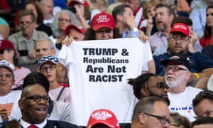 A Trump supporter holds up a T-shirt at a rally in Ohio earlier in August. Critics say the GOP's attempts to drop one radioactive member should not be mistaken for a party-wide purge.