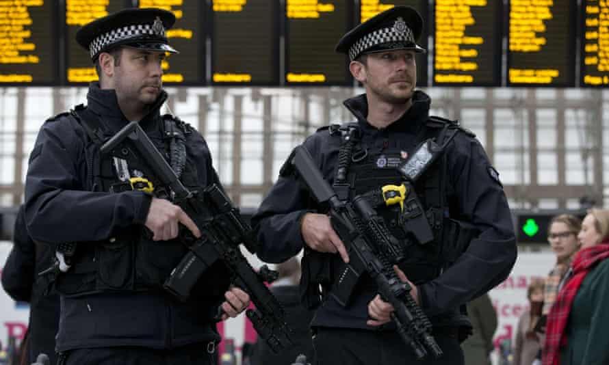 Armed transport police officers on patrol at London Bridge station