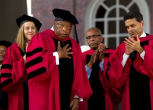 Lewis, center left, acknowledges a warm reception from the audience as CEO of Teach For America as he is awarded an honorary degree from Harvard in 2012. The degree was conferred for his work in the Civil Rights Movement.