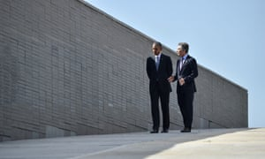 President Obama walks with President Macri walk beside a monument to the estimated 30,000 people who were killed or went missing under the 1976-1983 military regime.