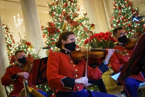 Washington DC, USA military band plays Christmas music in the Grand Foyer of the White House during the unveiling of their Christmas decoration. This year's theme is 'America the Beautiful'