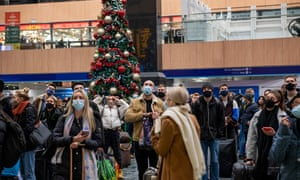 Passengers at Euston station last night waiting to leave London before the new tier 4 restrictions came into force.