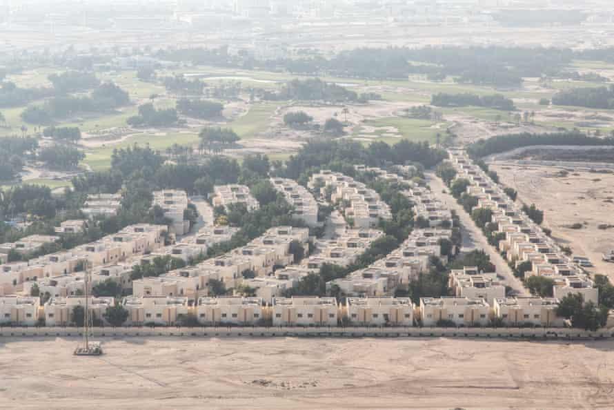 A neighbourhood with villas and a golf course.