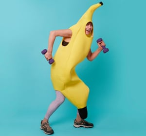 Zoe Williams holding hand weights and wearing banana costume