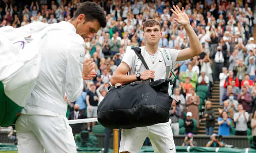 Jack Draper waves to the Centre Court crowd after his defeat to Novak Djokovic