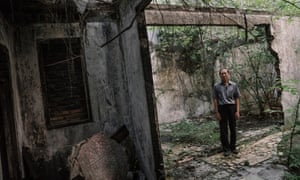 Tjie Thiang Siak (69) posed inside a three story building that he owns which was burned down during the May 1998 riot in the Chinatown of Glodok in West Jakarta, Indonesia.
