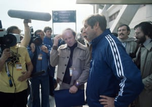 Scotland manager Ally McLeod faces the media after his team had been knocked out of the World Cup. BBC reporter Tony Gubba (beige jacket) is among those asking the questions.