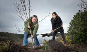 Hyeyoung Jin, from North Korea, and Eden Project lead horticulturalist, Julie Kendall, plant a Magnolia Seiboldii tree.