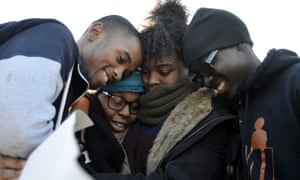 Members of Concerned Student 1950 embrace after the announcement that University of Missouri System President Tim Wolfe would resign.