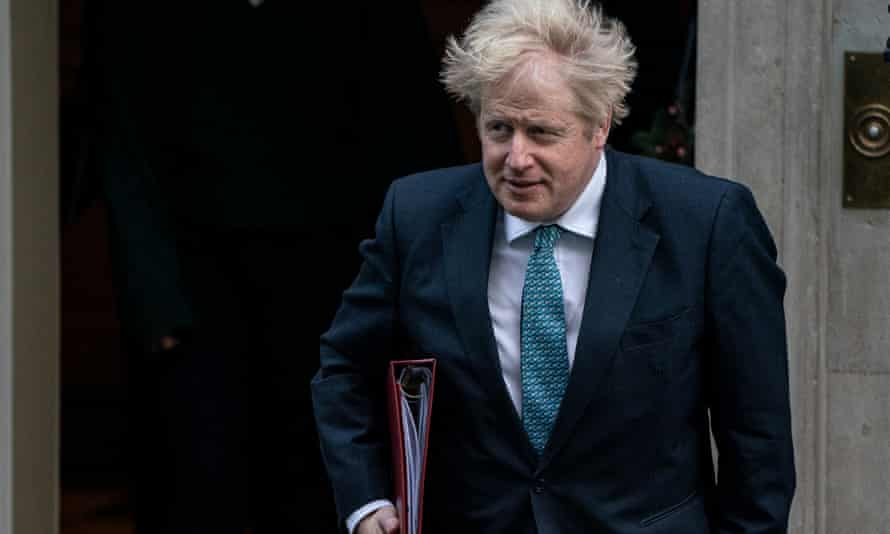 Prime Minister Boris Johnson walks to the foreign office, where the Cabinet meetings are being held.