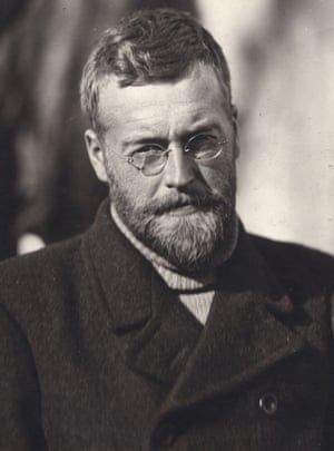 James Wordie, wearing metal framed spectacles and a beard, faces the camera.