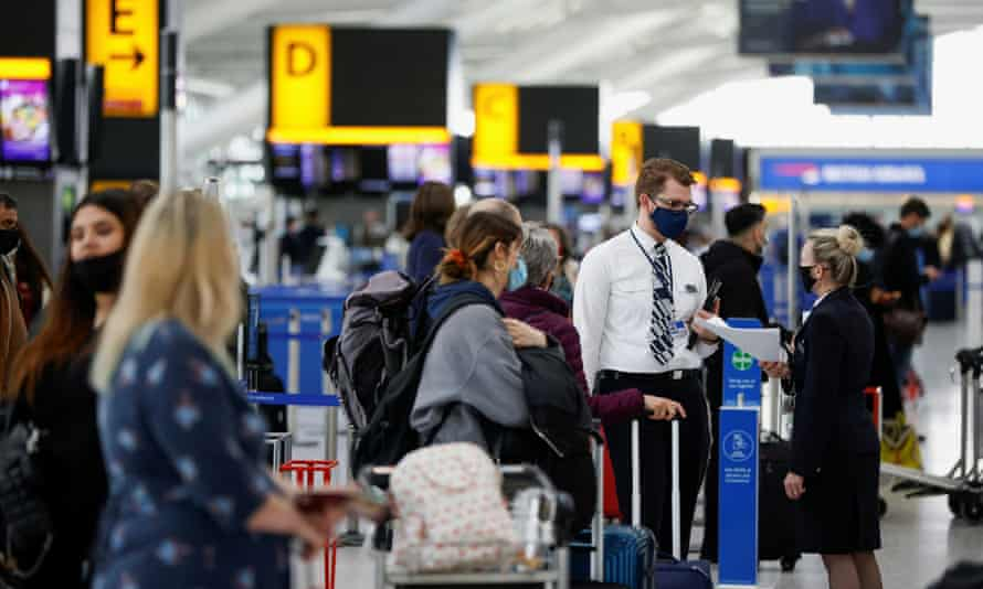 Passengers queue to check in at Heathrow