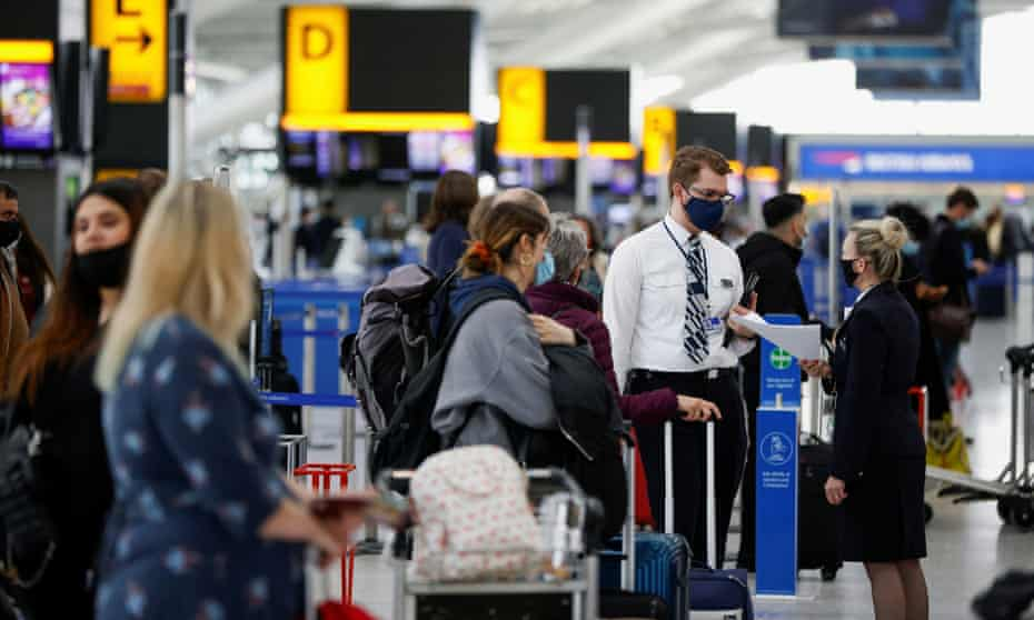Passengers queueing to check in at Heathrow Airport on Monday.
