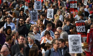 Momentum members rally in support of Jeremy Corbyn outside the Houses of Parliament in London.