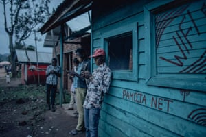 Residents stand outside Patick's WiFi office
