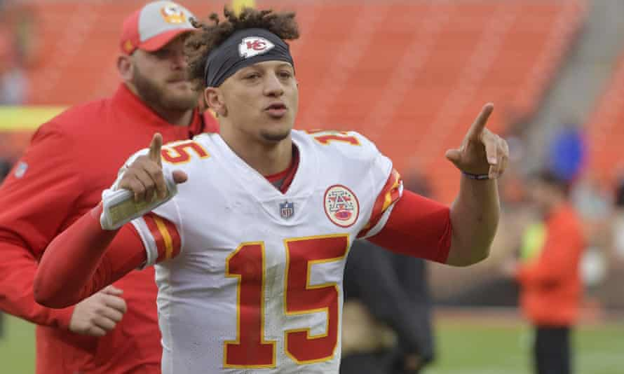 Patrick Mahomes celebrates as he runs off the field after his team defeated the Cleveland Browns