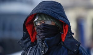 A man braves the freezing weather in Chicago, Illinois Thursday.
