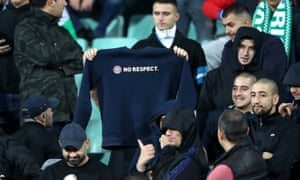A Bulgaria ultra displays a sweatshirt after an announcement over the Tannoy to cease their racist chanting in the England game.