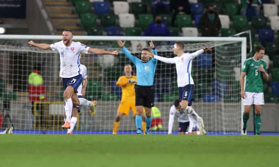 Slovakia's Milan Skriniar (left), who scored an own goal to throw Northern Ireland a lifeline, erupts on the final whistle.