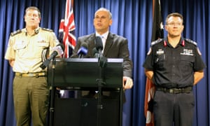 Adam Giles, chief minister of the Northern Territory, flanked by corrections commissioner Mark Payne (left) and police commissioner Reece Kershaw, at a press conference about the revelations of abuse of young detainees in the Don Dale correctional facility