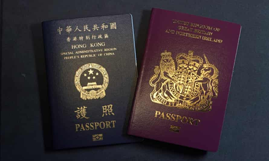 In this file photo, a British National Overseas passports (BNO) and a Hong Kong Special Administrative Region of the People's Republic of China passport are pictured in Hong Kong.